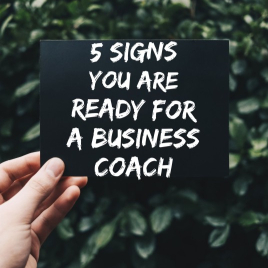 """Sign that reads, """"5 Signs you are ready for a business coach"""""""